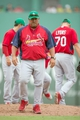Mar 17, 2014; Fort Myers, FL, USA; St. Louis Cardinals pitching coach Derek Lilliquist (34) comes off the mound after talking to starting pitcher Tyler Lyons (70) after Lyons gives up a home run to Boston Red Sox first baseman Mike Napoli (not pictured) at JetBlue Park. The Boston Red Sox defeated the St. Louis Cardinals 10-5. Mandatory Credit: Jerome Miron-USA TODAY Sports