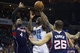 Mar 17, 2014; Charlotte, NC, USA; Charlotte Bobcats guard Kemba Walker (15) goes up for a shot during the second half against the Atlanta Hawks at Time Warner Cable Arena. Atlanta defeated Charlotte 97-83. Mandatory Credit: Jeremy Brevard-USA TODAY Sports