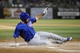 Mar 18, 2014; Surprise, AZ, USA; Chicago Cubs catcher Rafael Lopez (82) slides at home plate to score a run in the third inning against the Texas Rangers at Surprise Stadium. Mandatory Credit: Joe Camporeale-USA TODAY Sports