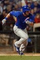 Mar 18, 2014; Surprise, AZ, USA; Chicago Cubs center fielder Ryan Kalish (51) runs to first base after hitting a single against the Texas Rangers at Surprise Stadium. Mandatory Credit: Joe Camporeale-USA TODAY Sports
