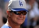 Mar 11, 2014; Surprise, AZ, USA;  Los Angeles Dodgers manager Don Mattingly during the fifth inning against the Kansas City Royals at Surprise Stadium. Mandatory Credit: Christopher Hanewinckel-USA TODAY Sports