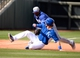 Mar 11, 2014; Surprise, AZ, USA;  Los Angeles Dodgers third baseman Juan Uribe (5) tags out Kansas City Royals infielder Jason Donald (45) during the sixth inning at Surprise Stadium. Mandatory Credit: Christopher Hanewinckel-USA TODAY Sports