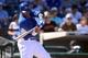 Mar 22, 2014; Surprise, AZ, USA; Kansas City Royals shortstop Alcides Escobar (2) hits a double against the Texas Rangers at Surprise Stadium. Mandatory Credit: Joe Camporeale-USA TODAY Sports