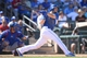 Mar 22, 2014; Surprise, AZ, USA; Kansas City Royals first baseman Eric Hosmer (35) follows through on a swing against the Texas Rangers at Surprise Stadium. Mandatory Credit: Joe Camporeale-USA TODAY Sports