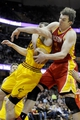 Mar 22, 2014; Cleveland, OH, USA; Houston Rockets center Omer Asik (3) and Cleveland Cavaliers center Tyler Zeller (40) go for a rebound during the second quarter at Quicken Loans Arena. Mandatory Credit: Ken Blaze-USA TODAY Sports