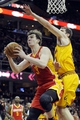 Mar 22, 2014; Cleveland, OH, USA; Houston Rockets center Omer Asik (3) shoots under the defense of Cleveland Cavaliers center Tyler Zeller (40) during the second quarter at Quicken Loans Arena. Mandatory Credit: Ken Blaze-USA TODAY Sports