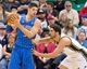 Mar 22, 2014; Salt Lake City, UT, USA; Utah Jazz center Enes Kanter (0) defends against Orlando Magic center Nikola Vucevic (9) during the second half at EnergySolutions Arena. The Jazz won 89-88. Mandatory Credit: Russ Isabella-USA TODAY Sports