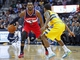 Mar 23, 2014; Denver, CO, USA; Denver Nuggets point guard Aaron Brooks (0) guards Washington Wizards point guard John Wall (2) in the first quarter at the Pepsi Center. Mandatory Credit: Isaiah J. Downing-USA TODAY Sports