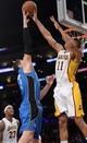 Mar 23, 2014; Los Angeles, CA, USA; Los Angeles Lakers forward Wesley Johnson (11) blocks a shot by Orlando Magic forward Nikola Vucevic (9) at Staples Center. Mandatory Credit: Kirby Lee-USA TODAY Sports