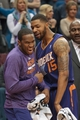 Mar 23, 2014; Minneapolis, MN, USA; Phoenix Suns forward Marcus Morris (R) celebrates with guard Dionte Christmas (L) in the fourth quarter against the Minnesota Timberwolves at Target Center. The Suns won 127-120. Mandatory Credit: Brad Rempel-USA TODAY Sports