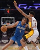 Mar 23, 2014; Los Angeles, CA, USA; Orlando Magic forward Arron Afflalo (4) dribbles the ball as Los Angeles Lakers forward Kent Bazemore (6) defends at Staples Center. Mandatory Credit: Kirby Lee-USA TODAY Sports