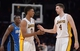 Mar 23, 2014; Los Angeles, CA, USA; Los Angeles Lakers guard Nick Young (0) celebrates with forward Ryan Kelly (4) in the final minute against the Orlando Magic at Staples Center. The Lakers won 103-94. Mandatory Credit: Kirby Lee-USA TODAY Sports