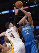 Mar 23, 2014; Los Angeles, CA, USA; Orlando Magic forward Tobias Harris (12) is fouled by Los Angeles Lakers forward Ryan Kelly (4) at Staples Center. The Lakers won 103-94. Mandatory Credit: Kirby Lee-USA TODAY Sports