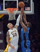 Mar 23, 2014; Los Angeles, CA, USA; Orlando Magic forward Kyle O'Quinn (2) shoots the ball as Los Angeles Lakers center Robert Sacre (50) defends at Staples Center. The Lakers won 103-94. Mandatory Credit: Kirby Lee-USA TODAY Sports