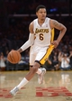 Mar 23, 2014; Los Angeles, CA, USA; Los Angeles Lakers forward Kent Bazemore (6) dribbles the ball against the Orlando Magic at Staples Center. The Lakers won 103-94. Mandatory Credit: Kirby Lee-USA TODAY Sports