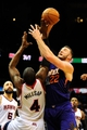 Mar 24, 2014; Atlanta, GA, USA; Phoenix Suns center Miles Plumlee (22) and Atlanta Hawks forward Paul Millsap (4) fight for a rebound during the first half at Philips Arena. Mandatory Credit: Dale Zanine-USA TODAY Sports