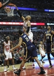 Mar 24, 2014; Chicago, IL, USA;  Chicago Bulls forward Taj Gibson (22) dunks the ball against Indiana Pacers forward Evan Turner (12) during the first half at the United Center. Mandatory Credit: David Banks-USA TODAY Sports