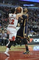 Mar 24, 2014; Chicago, IL, USA; Indiana Pacers forward Paul George (24) is defended by Chicago Bulls guard Kirk Hinrich (12) during the second half at the United Center. the Chicago Bulls defeated the Indiana Pacers 89-77. Mandatory Credit: David Banks-USA TODAY Sports
