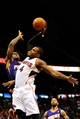 Mar 24, 2014; Atlanta, GA, USA; Atlanta Hawks forward Paul Millsap (4) is fouled by Phoenix Suns guard Eric Bledsoe (2) while attempting a dunk during the second half at Philips Arena. The Suns defeated the Hawks 102-95. Mandatory Credit: Dale Zanine-USA TODAY Sports