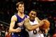 Mar 24, 2014; Atlanta, GA, USA; Atlanta Hawks guard Jeff Teague (0) drives past Phoenix Suns guard Goran Dragic (1) during the second half at Philips Arena. The Suns defeated the Hawks 102-95. Mandatory Credit: Dale Zanine-USA TODAY Sports