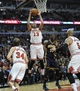 Mar 24, 2014; Chicago, IL, USA;  Chicago Bulls center Joakim Noah (13) grabs a rebound against the Indiana Pacers during the second half at the United Center. the Chicago Bulls defeated the Indiana Pacers 89-77. Mandatory Credit: David Banks-USA TODAY Sports