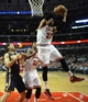 Mar 24, 2014; Chicago, IL, USA; Chicago Bulls forward Taj Gibson (22) grabs a rebound over Indiana Pacers forward Luis Scola (4) during the second half at the United Center. the Chicago Bulls defeated the Indiana Pacers 89-77. Mandatory Credit: David Banks-USA TODAY Sports