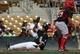 Mar 26, 2014; Phoenix, AZ, USA; Chicago White Sox first baseman Jose Abreu (79) scores a run in the first inning against the Cincinnati Reds at Camelback Ranch. Mandatory Credit: Rick Scuteri-USA TODAY Sports