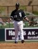 Mar 26, 2014; Phoenix, AZ, USA; Chicago White Sox second baseman Leury Garcia (28) reacts after making an error against the Cincinnati Reds at Camelback Ranch. Mandatory Credit: Rick Scuteri-USA TODAY Sports
