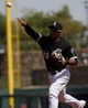 Mar 26, 2014; Phoenix, AZ, USA; Chicago White Sox second baseman Leury Garcia (28) commits a throwing error against the Cincinnati Reds in the third inning at Camelback Ranch. Mandatory Credit: Rick Scuteri-USA TODAY Sports