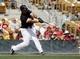 Mar 26, 2014; Phoenix, AZ, USA; Chicago White Sox first baseman Jose Abreu (79) hits a three run home run against the Cincinnati Reds in the fourth inning at Camelback Ranch. Mandatory Credit: Rick Scuteri-USA TODAY Sports