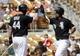 Mar 26, 2014; Phoenix, AZ, USA; Chicago White Sox first baseman Jose Abreu (79) gets a high five from Adam Dunn (44) after hitting a three run home run against the Cincinnati Reds in the fourth inning at Camelback Ranch. Mandatory Credit: Rick Scuteri-USA TODAY Sports