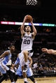 Mar 26, 2014; San Antonio, TX, USA; San Antonio Spurs guard Manu Ginobili (20) drives to the basket against the Denver Nuggets during the second half at AT&T Center. The Spurs won 108-103. Mandatory Credit: Soobum Im-USA TODAY Sports
