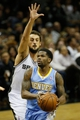Mar 26, 2014; San Antonio, TX, USA; Denver Nuggets guard Aaron Brooks (0) drives to the basket past San Antonio Spurs forward Marco Belinelli (behind) during the first half at AT&T Center. Mandatory Credit: Soobum Im-USA TODAY Sports