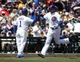 Mar 27, 2014; Mesa, AZ, USA; Chicago Cubs center fielder Ryan Sweeney (6) gets a high five from Gary Jones (1) after hitting a solo home run against the Chicago White Sox in the second inning at HoHoKam Park. Mandatory Credit: Rick Scuteri-USA TODAY Sports