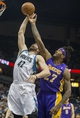 Mar 28, 2014; Minneapolis, MN, USA; Minnesota Timberwolves forward Kevin Love (42) battles for a rebound with Los Angeles Lakers forward Jordan Hill (27) in the first half at Target Center. Mandatory Credit: Jesse Johnson-USA TODAY Sports