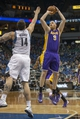 Mar 28, 2014; Minneapolis, MN, USA; Los Angeles Lakers center Chris Kaman (9) shoots the ball over Minnesota Timberwolves center Nikola Pekovic (14) in the first half at Target Center. Mandatory Credit: Jesse Johnson-USA TODAY Sports