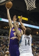 Mar 28, 2014; Minneapolis, MN, USA; Los Angeles Lakers forward Ryan Kelly (4) shoots the ball as Minnesota Timberwolves center Nikola Pekovic (14) defends in the first half at Target Center. Mandatory Credit: Jesse Johnson-USA TODAY Sports