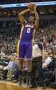Mar 28, 2014; Minneapolis, MN, USA; Los Angeles Lakers forward Nick Young (0) shoots the ball in the first half against the Minnesota Timberwolves at Target Center. Mandatory Credit: Jesse Johnson-USA TODAY Sports