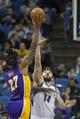 Mar 28, 2014; Minneapolis, MN, USA; Los Angeles Lakers forward Jordan Hill (27) goes up for a shot over Minnesota Timberwolves center Nikola Pekovic (14) in the second half at Target Center. The Timberwolves won 143-107. Mandatory Credit: Jesse Johnson-USA TODAY Sports