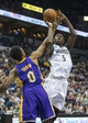 Mar 28, 2014; Minneapolis, MN, USA; Minnesota Timberwolves center Gorgui Dieng (5) goes up for a shot over Los Angeles Lakers forward Nick Young (0) in the second half at Target Center. The Timberwolves won 143-107. Mandatory Credit: Jesse Johnson-USA TODAY Sports