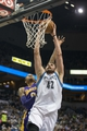 Mar 28, 2014; Minneapolis, MN, USA; Minnesota Timberwolves forward Kevin Love (42) dunks the ball past Los Angeles Lakers guard Kent Bazemore (6) in the second half at Target Center. The Timberwolves won 143-107. Mandatory Credit: Jesse Johnson-USA TODAY Sports