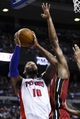 Mar 28, 2014; Auburn Hills, MI, USA; Detroit Pistons forward Greg Monroe (10) shoots on Miami Heat center Chris Bosh (1) in the second half at The Palace of Auburn Hills. Miami won 110-78. Mandatory Credit: Rick Osentoski-USA TODAY Sports