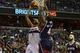 Mar 29, 2014; Washington, DC, USA; Washington Wizards forward Trevor Ariza (1) shoots over Atlanta Hawks forward Paul Millsap (4) during the first quarter at Verizon Center. Mandatory Credit: Tommy Gilligan-USA TODAY Sports