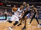 Mar 29, 2014; Dallas, TX, USA; Dallas Mavericks guard Monta Ellis (11) drives to the basket past Sacramento Kings forward Travis Outlaw (25) during the first half at the American Airlines Center. Mandatory Credit: Jerome Miron-USA TODAY Sports