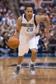 Mar 29, 2014; Dallas, TX, USA; Dallas Mavericks guard Devin Harris (20) drives to the basket during the first half against the Sacramento Kings at the American Airlines Center. Mandatory Credit: Jerome Miron-USA TODAY Sports
