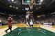 Mar 29, 2014; Milwaukee, WI, USA; Miami Heat guard Toney Douglas (0) passes the ball aroung Milwaukee Bucks forward Jeff Adrien (12) during the third quarter at BMO Harris Bradley Center. Mandatory Credit: Jeff Hanisch-USA TODAY Sports