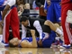 Mar 29, 2014; Houston, TX, USA; Los Angeles Clippers forward Blake Griffin (32) is evaluated by medical staff during the first quarter against the Houston Rockets at Toyota Center. The Clippers defeated the Rockets 118-107. Mandatory Credit: Troy Taormina-USA TODAY Sports