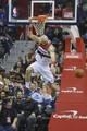 Mar 29, 2014; Washington, DC, USA; Washington Wizards center Marcin Gortat (4) hangs on the rim after dunking during the fourth quarter of the game against the the Atlanta Hawks  at Verizon Center. Washington Wizards defeated Atlanta Hawks 101-97. Mandatory Credit: Tommy Gilligan-USA TODAY Sports