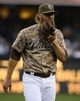 Mar 30, 2014; San Diego, CA, USA; San Diego Padres starting pitcher Andrew Cashner (34) reacts after allowing a run in the fifth inning on the opening day baseball game against the Los Angeles Dodgers at Petco Park. Mandatory Credit: Christopher Hanewinckel-USA TODAY Sports