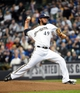 Mar 31, 2014; Milwaukee, WI, USA;  Milwaukee Brewers pitcher Yovani Gallardo (49) pitches in the first inning against the Atlanta Braves of an opening day baseball game at Miller Park. Mandatory Credit: Benny Sieu-USA TODAY Sports